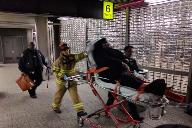 Emergency responders transport an injured woman from Atlantic Terminal Wednesday.