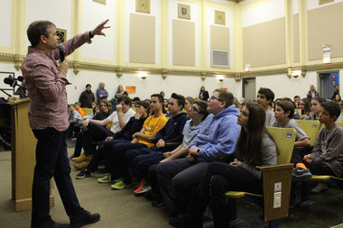 U.S. Rep. Mike Quigley talks with Alcott College Prep students heading to the presidential inauguration next week.