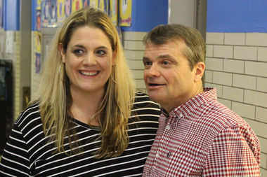 Alcott teacher Jenny Vincent, who'll led the trip to the inauguration, meets US. Rep. Mike Quigley after he addressed the students.