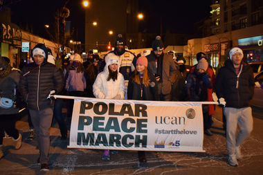 An earlier Polar Peace March proceeds down Clark Street.