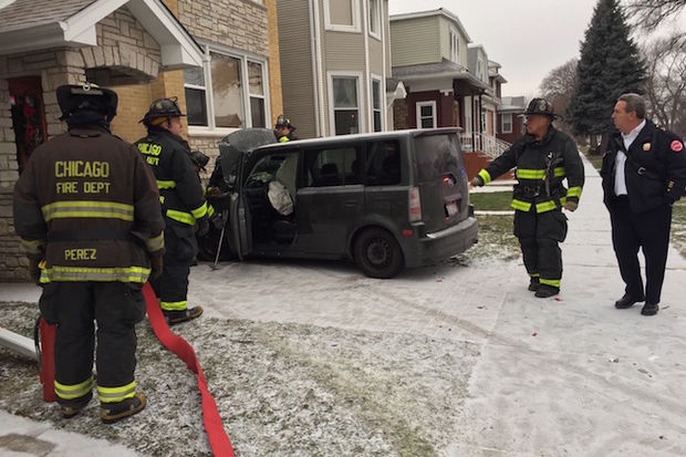 A woman jumped into an idling car and hit five other cars before crashing it into the front of a home, police said.