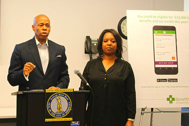 Brooklyn Borough President Eric Adams partnered with Benefit Kitchen, an app that helps New Yorkers learn about their eligibility for public benefits. Bed-Stuy resident Shadia Barneys (right), said she found she could save up to $100 a month after using the app.