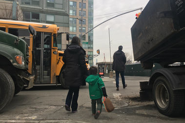 Parents and children dodged massive delivery trucks, school buses and bikers through a faded crosswalk across from the Williamsburg Montessori School on Kent Ave. Tuesday morning.