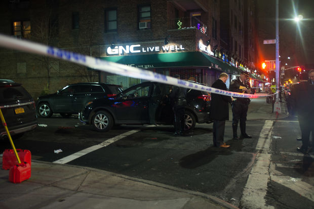 NYPD investigators at the scene of a pedestrian fatality in the intersection of 76th Street and 37th Avenue on Wednesday, Jan. 18, 2016.