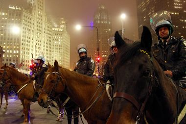 Mounted police officers monitor Inauguration Day protests on Michigan Avenue.