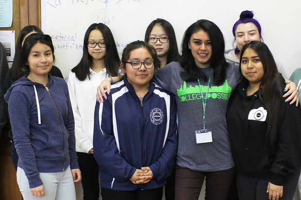 Doris Medina (wearing College Possible T-shirt) helps the seniors at Kelly High School apply to four-year universities.