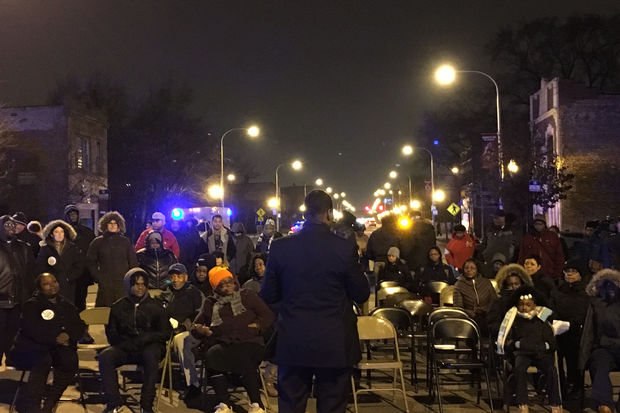 The rally was just feet from the site of a midday Sunday shooting that left four people wounded.