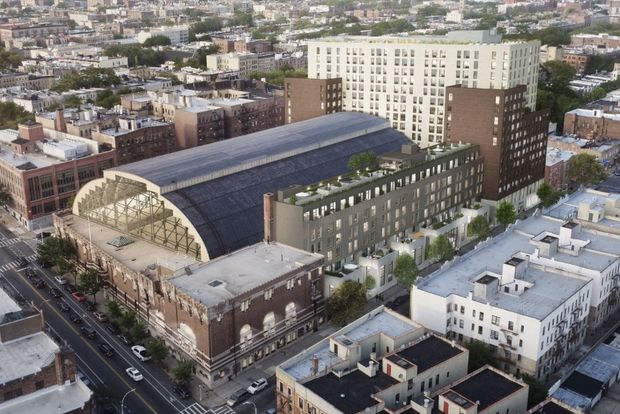 A rendering of the Bedford-Union Armory redevelopment shows the building with added apartments and condominiums. The project would also create a 35,000-square-foot recreation center inside the building's domed former drill hall.