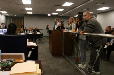 Surrounded by her students, Steinmetz College Prep English teacher Sharon Schmidt speaks during the public comment period at the CPS Board of Education's monthly meeting.