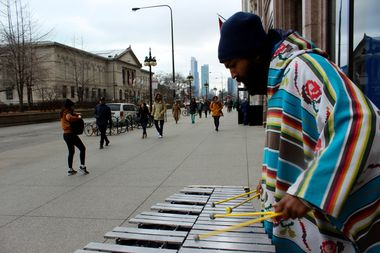 Preyas Roy, 32, has been playing the vibraphone on Michigan Avenue for three years.