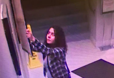 A video shows woman removing a painting from a nonprofit arts organization in Logan Square.