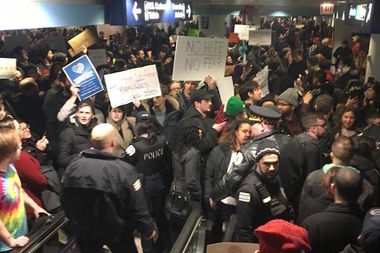 Protesters pack O'Hare Terminal 5 to demand the release of green card holders who had been detained because of President Donald Trump's executive order restricting travel.