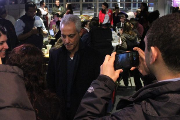 Mayor Rahm Emanuel speaks with lawyers volunteering on behalf of detained travelers Sunday.