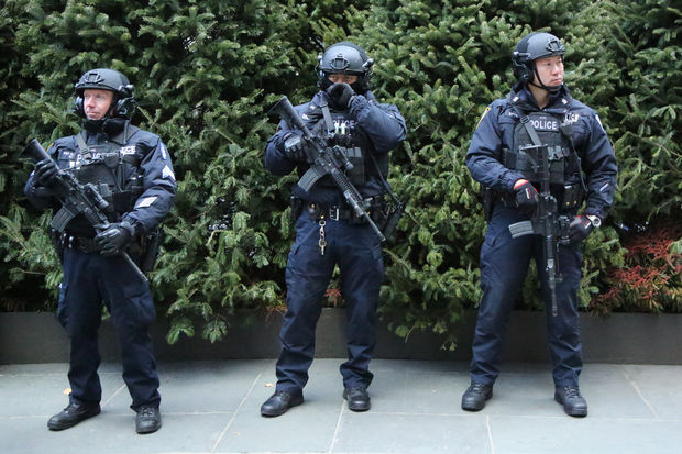 NYPD counterterrorism officers providing security at Rockefeller Center in midtown Manhattan on Dec. 15, 2016.
