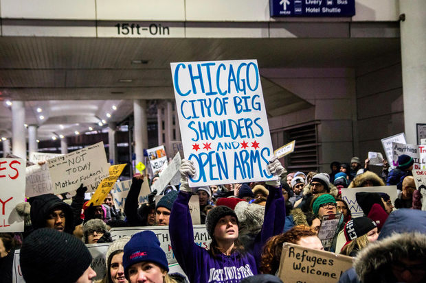 Hundreds of protesters and dozens of volunteer lawyers greeted foreign travelers at O'Hare Sunday.