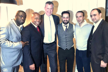 Mayor Bill de Blasio and Brooklyn Borough President Eric Adams have hosted fundraisers at the controversial restaurant Woodland NYC. Here the two politicians are posing with Zhan Petrosyants (third from the right), one of the restaurant operators who is also a convicted felon.