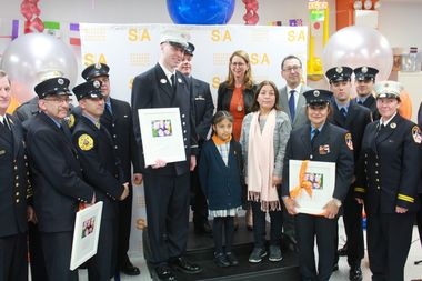 Emely Hernandez, 7, suffered a heart attack when a fire engulfed her Upper West Side apartment building last month. On Tuesday, she was reunited with the first responders who helped save her.