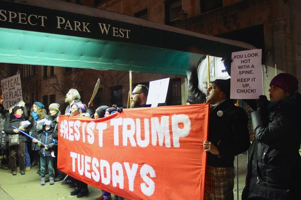 Protesters rallied outside U.S. Sen. Chuck Schumer's Park Slope apartment building on Jan. 31, 2017 to urge the Senate minority leader to block President Donald Trump's cabinet nominees.
