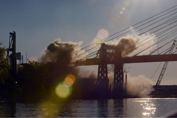 The bridge hit the ground with a cacophonous explosion that could be hear for miles away.