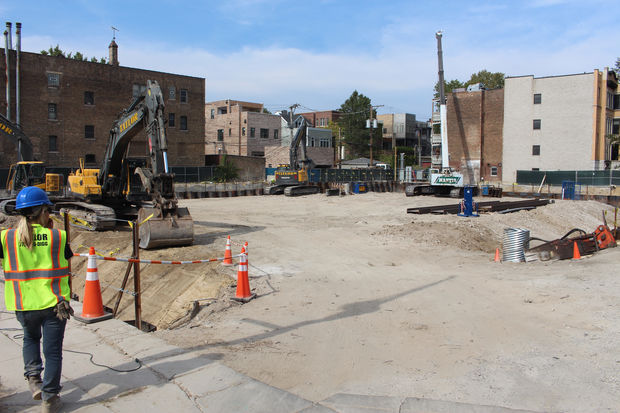 The caissons are installed and excavation continues at the Belmont Village construction site.