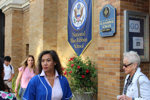 Principal Nel Mullens and Lorelei Bobroff of the Chicago Archdiocese outside St. Josaphat School before Tuesday's pep rally.
