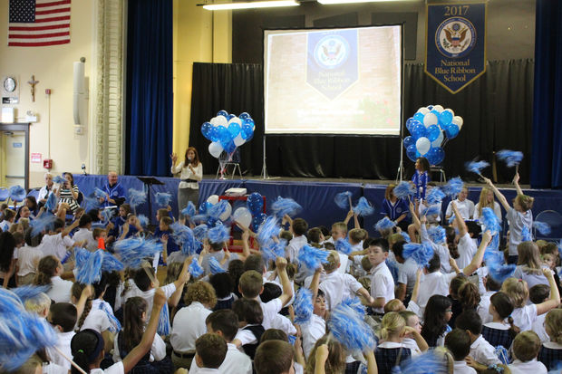 Cook County Commissioner Bridget Gainer thanks parents at the St. Josaphat School pep rally.