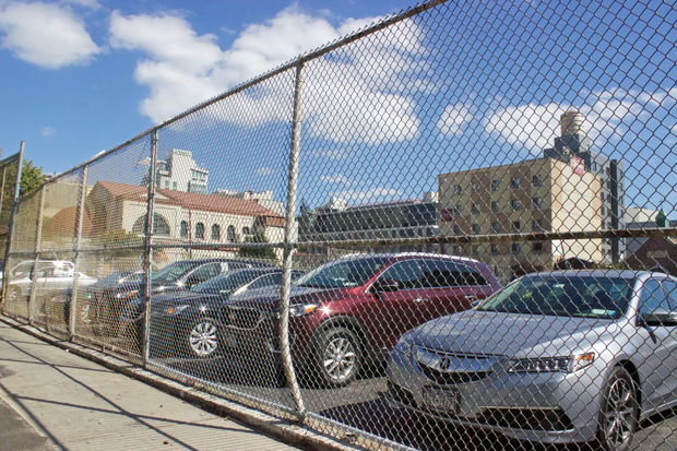 The site of the future school building at40-11 28th St. is currently a parking lot next door to Newcomers High School.