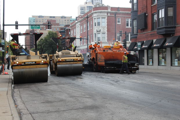 Crews work on resurfacing the intersection of Broadway and Belmont Tuesday morning. Major construction on North Broadway, which started in November, is slated to be completed before Sunday's Chicago Marathon.