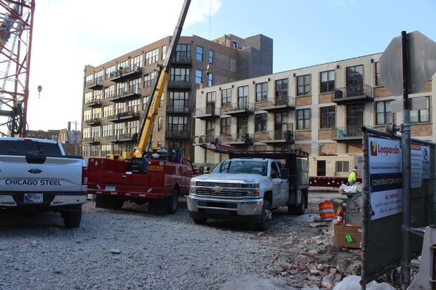 Construction is underway at 210 N. Carpenter St., and adjacent neighbors want the alderman to halt the project.