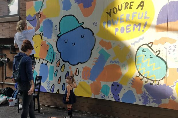 Dallas Clayton worked on a new mural along the side of the TOMS Shoe store in Wicker Park.