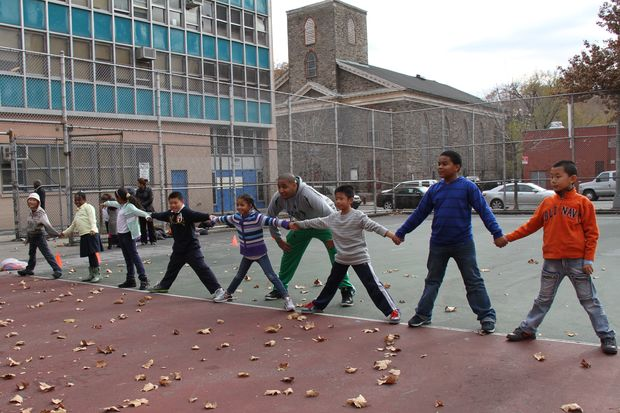 Kids from Chinatown's P.S. 134 in a game led by a coach from Asphalt Green's Recess Enhancement Program.