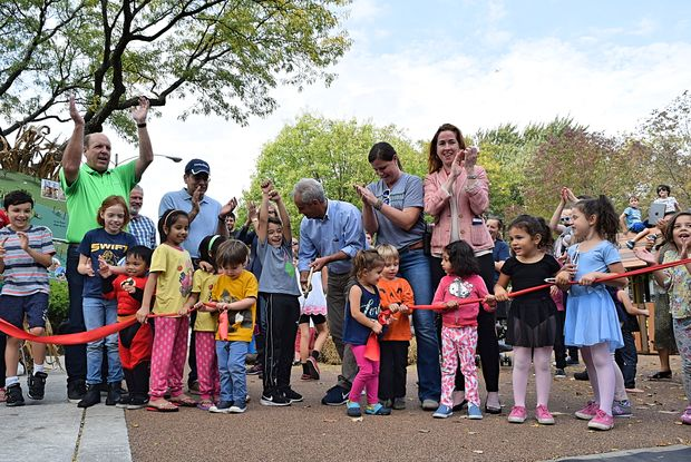 Ald. Harry Osterman (48th), Mayor Rahm Emnauel, Jesse Ruiz, President of Chicago Park District's Board of Commissioners, Senn High School Principal Mary Beck and Cook County Commissioner Bridget Gainer (10th District) cut the ribbon at Senn Playlot Park.