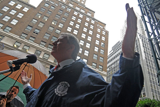 Mayor Bill de Blasio was questioned about the possible removal of statues ahead of marching in the Columbus Day Parade Monday, Oct. 9, 2017.