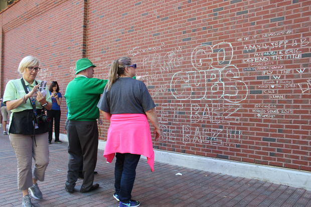 Cubs fans have once again been leaving chalk messages on the eastern wall of Wrigley Field as the team competes with the Washington Nationals in the NLDS.