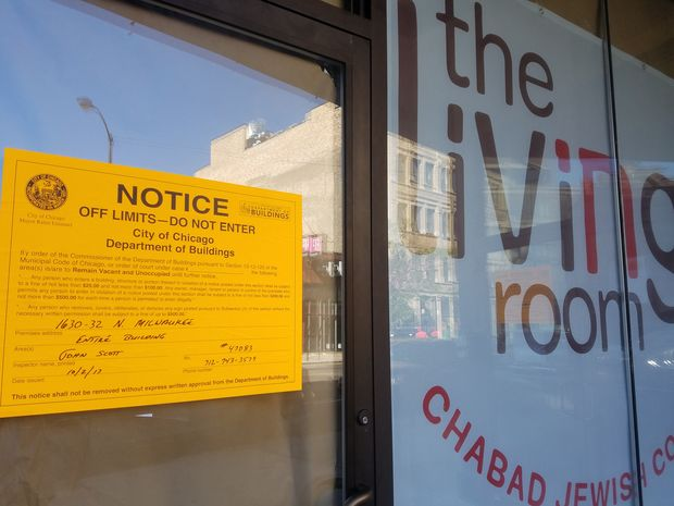 The Living Room was ordered closed by the Department of Buildings, according to a notice in the window of 1630-32 N. Milwaukee Ave.