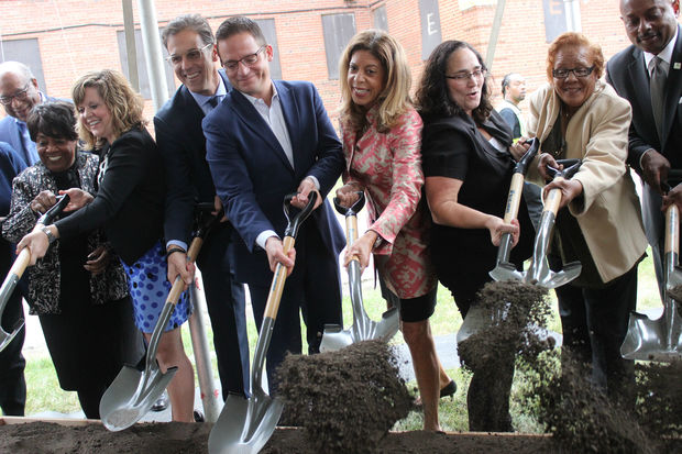 Public officials, developers and community members gathered for a groundbreaking ceremony Tuesday after more than eight years of planning and debate.