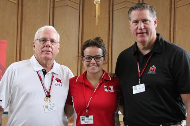 Marist President Br. Hank Hammer (left) and Principal Larry Tucker stand beside senior Samantha Reidy of Palos Heights, who scored 36 on the ACT.