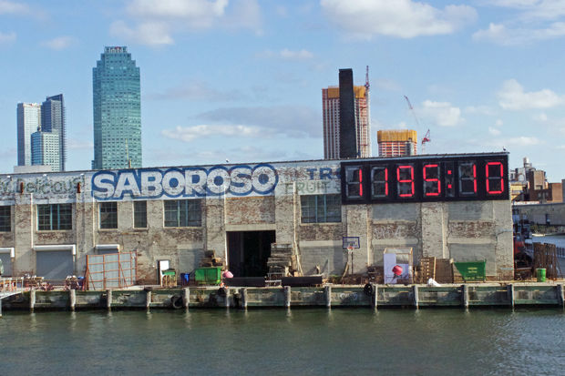 The display, affixed to a building on the Long Island City waterfront, is a clock counting down the time left in Donald Trump's presidency.