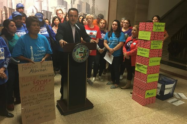 Ald. George Cardenas (12th) — along with a half-dozencommunity groups including theBrighton Park Neighborhood Council, Logan Square Neighborhood Association andParents 4 Teachers — called for the City Council to dipinto redevelopment funds and taxbig firms to fund schools.