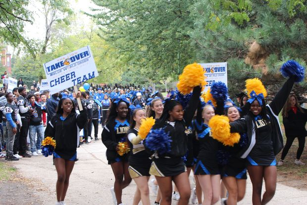 Cheerleaders lead off the first Lincoln Park High School homecoming parade.