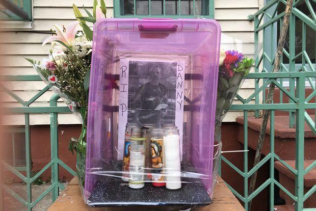 Residents build Rivera a shrine outside the Himrod Street home where he was killed.
