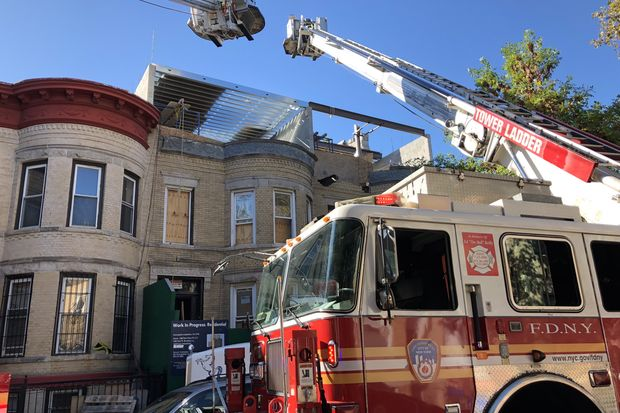 Four people were hurt in a partial building collapse in Crown Heights Tuesday morning, the FDNY said.