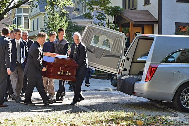 Cynthia Trevillion was laid to rest in a platinum Chrysler hearse that flashed purple lights Tuesday morning.
