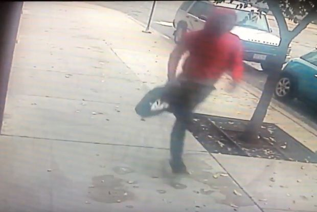 Video surveillance footage shows a person accused of robbing a woman at 9 a.m. Sunday in the West Loop.
