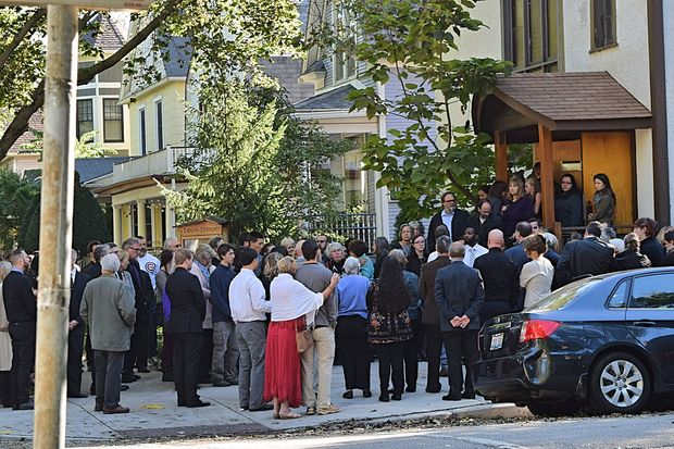Mourners pay respect to Cynthia Trevillion at her funeral Tuesday.