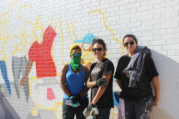 Jenny Q. (from left) is assisting Sam Kirk and Sandra Antongiorgi with the mural, which should be finished in about three weeks, weather permitting.