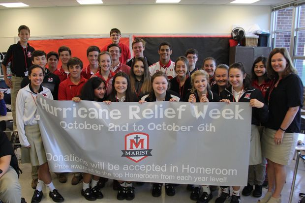 Marist High School students in Mrs. Natalie Holder's homeroom raised $448, the most money of any homeroom, during the school's hurricane relief fundraiser. They were rewarded with bagels and juice. The school community raised more than $6,000 in total.
