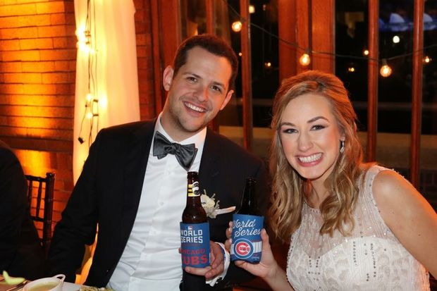 AJ and Jaime Etsch celebrate their wedding in Cubs style.