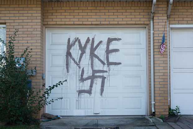 Vandal painted a giant swastika and a slur on the garage door of Debra Calabrese.