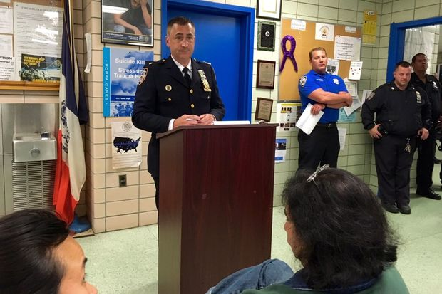 Deputy Inspector Robert Ramos discusses crime at a 112th Precinct community council meeting.